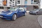 BMW 330e и Tesla Model 3: Три на три