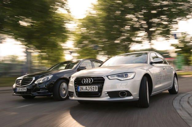 Audi A6 2.0 TDI Ultra срещу Mercedes E 220 Bluetec